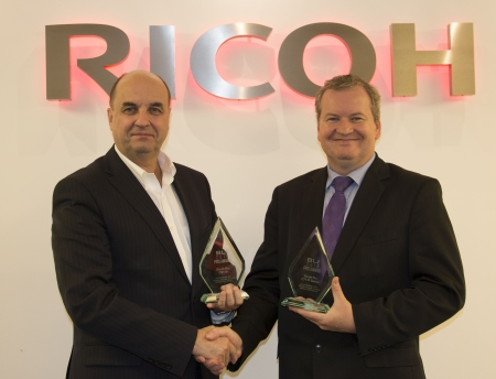 Benoit Chatelard, Vice President, Production Printing at Ricoh Europe receives an award from  David Sweetnam, Head of EMEA Research and Lab Services at BLI.